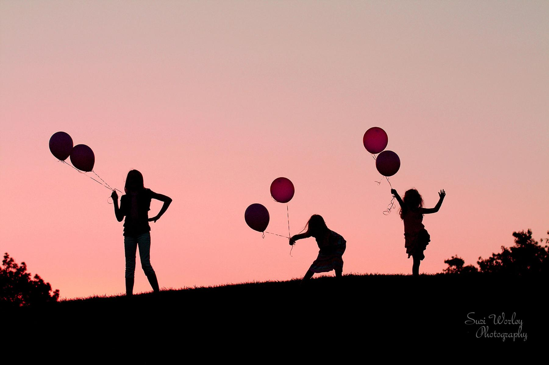 Sunset silhouette  #SuziWorleyPhotography #FamilyPictures #Balloons