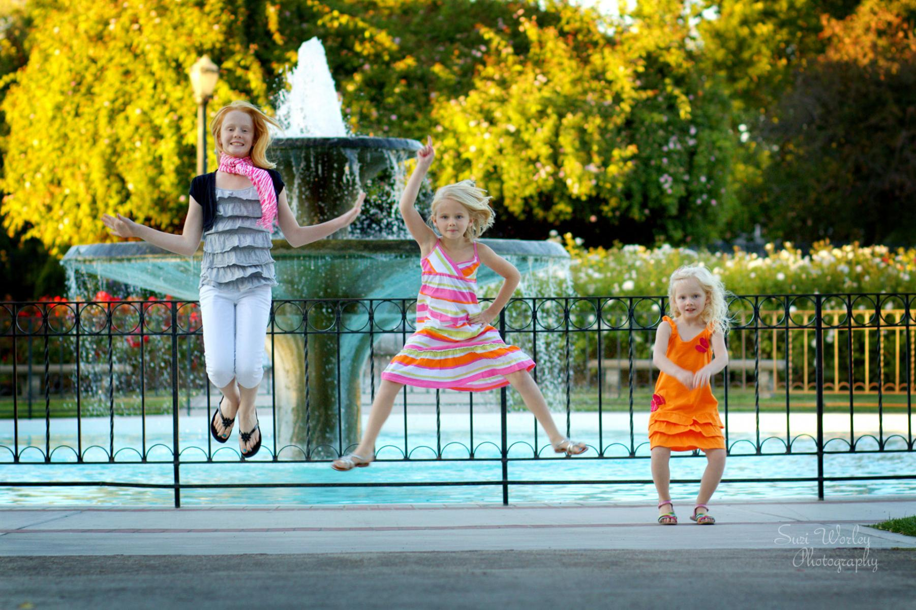 Jump!   #SpringPhoto #SuziWorleyPhotography #Portraits #girls #jump #family #fountain